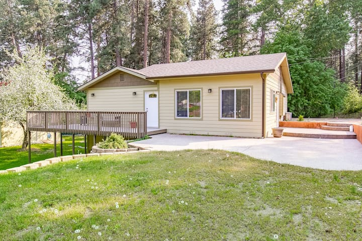 Quaint, two story home w/ a full kitchen, furnished deck, & enclosed yard