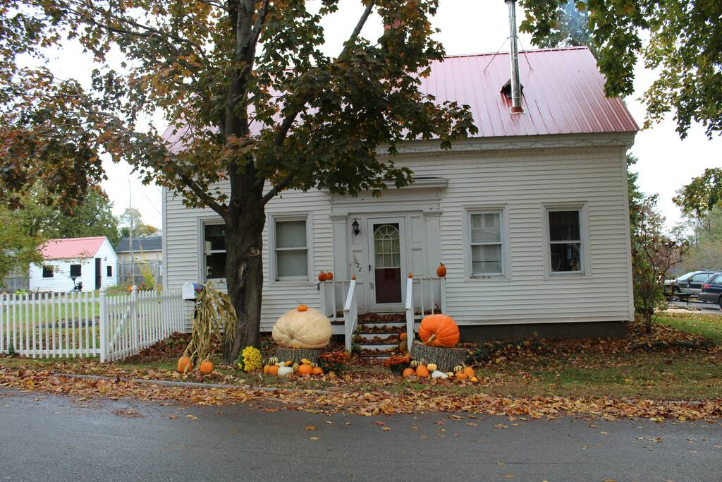 This is the front of our house with our fall pumpkin display.