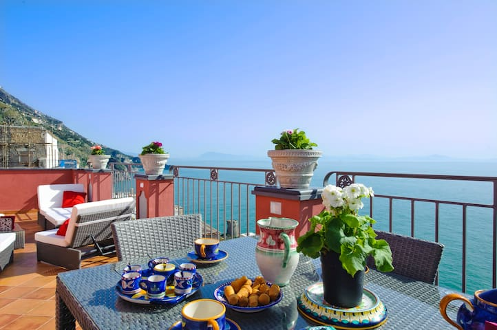 "Large terrace outdoor lounge /  dining, with views of the ""Capo di Conca"" with Norman tower and Saracen tower."