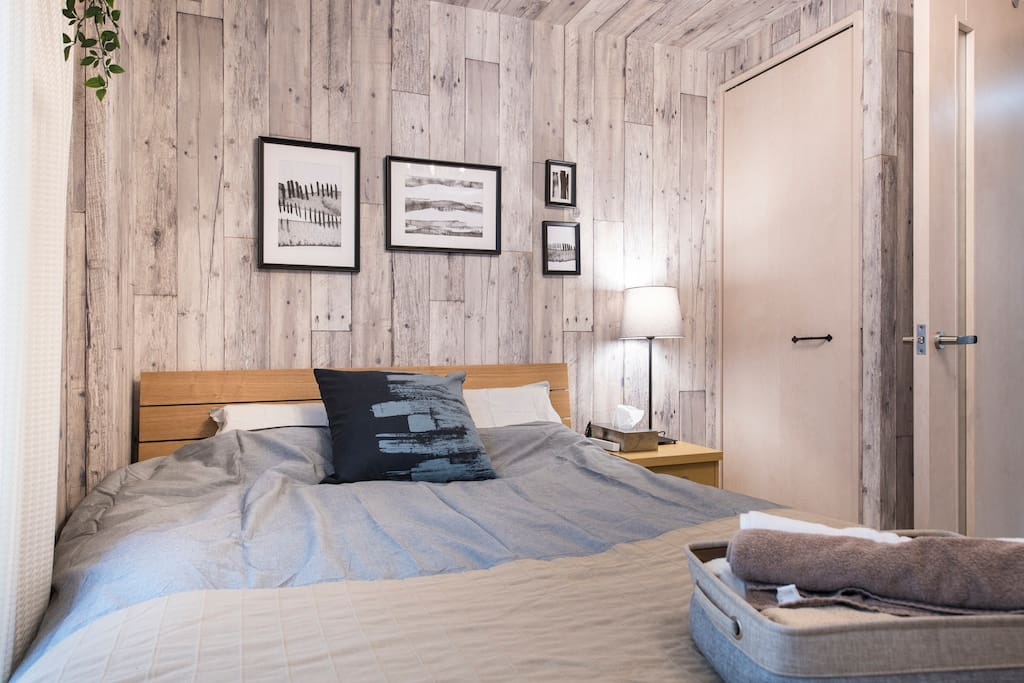 Wooden wall and clean bed