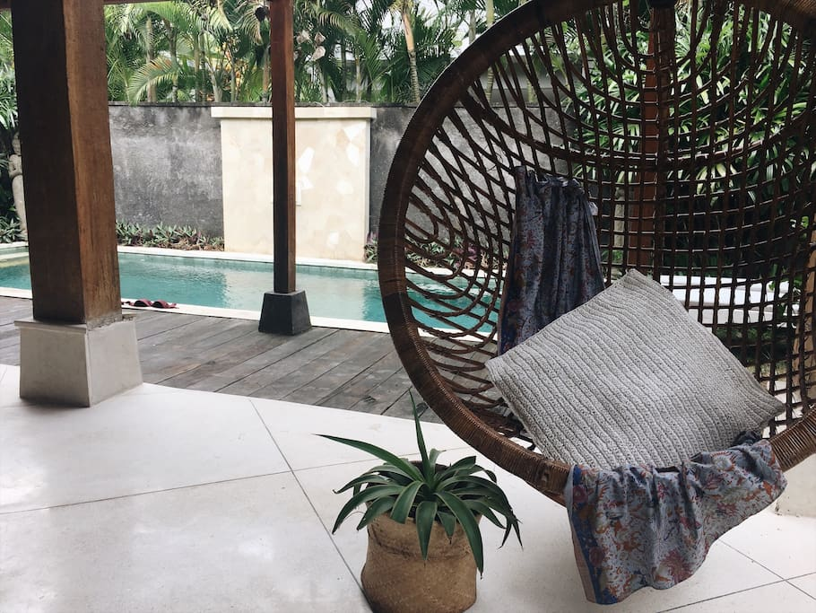 Tropical garden & pool with hanging chair
