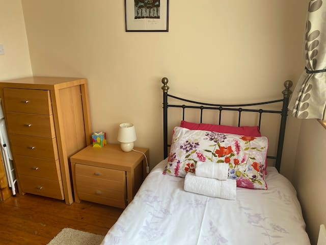 Single bedroom, front elevation with built in wardrobe.