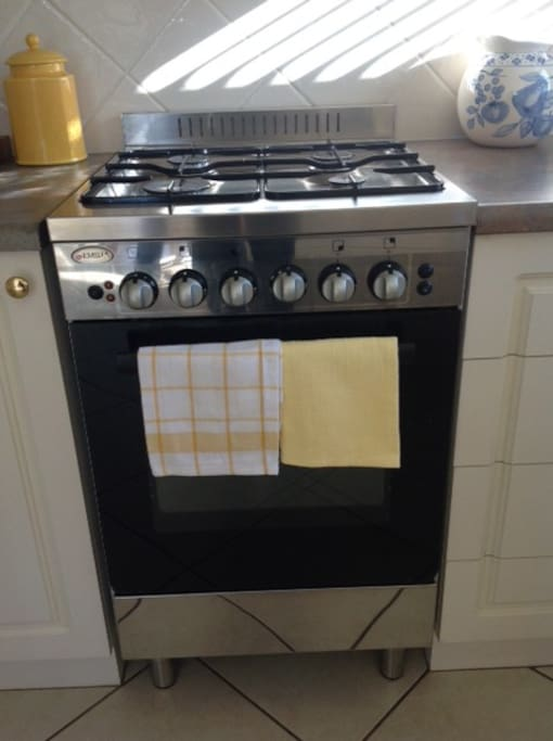 Electric oven with gas cooktop