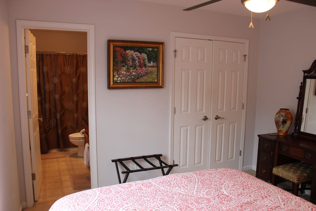 Closet space available in private bedroom with antique powder table.