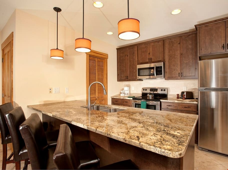 Enjoy cooking in the fully-equipped kitchen, complete with stainless steel appliances