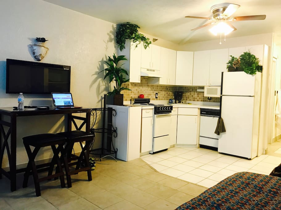 Desk area, wall fireplace, efficiency kitchen fully equipped.