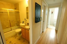 Full bathroom (with washer and dryer) on left.  Half bathroom at the end of the hallway.