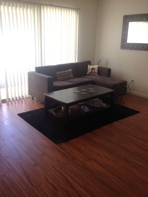 Living room with angle couch & coffee table
