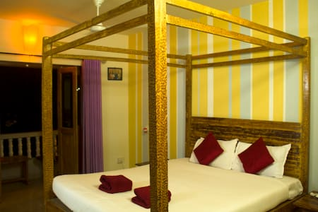 Luxurious yellow themed room by Ashwem beach