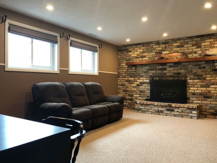 Living area with fireplace, recliner couch and desk