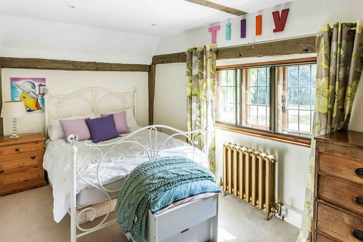 Double Bedroom 4 - views to south over front garden. 6 drawer chest and radio/cd player.