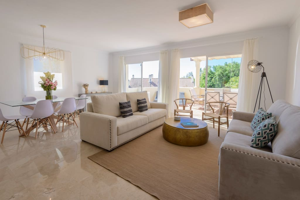 Lower Floor - Ample living room, comfortable sofas, dining area and international TV