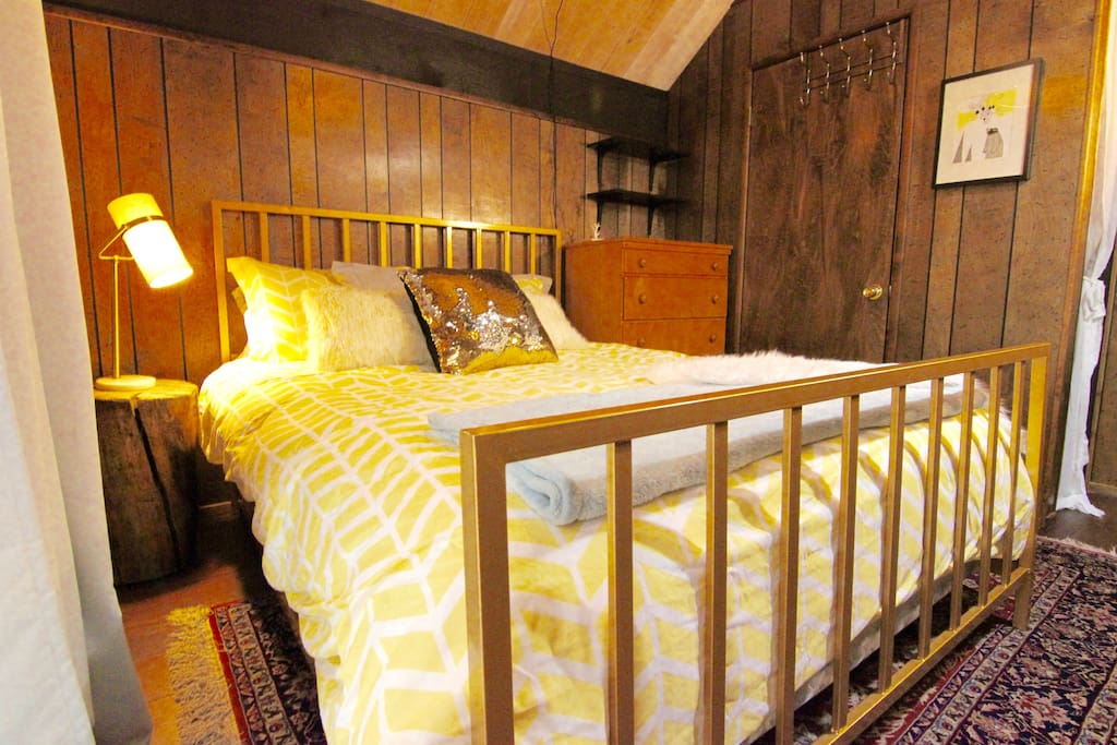 luxuriously comfortable upstairs bedroom with flat screen