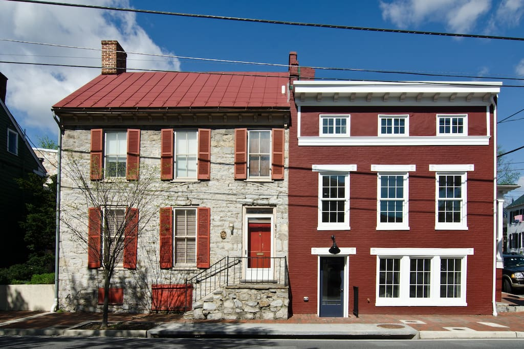 Wickham House (left) shares a party wall with the recently renovated Samuel Noakes House (right)
