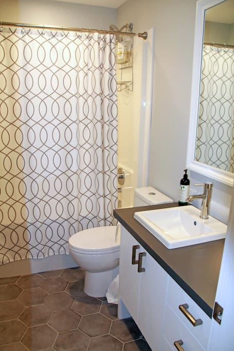 Bath tub and shower. Shower curtains are washed between each and every guest. We provide shampoo, conditioner, body wash and shaving cream.