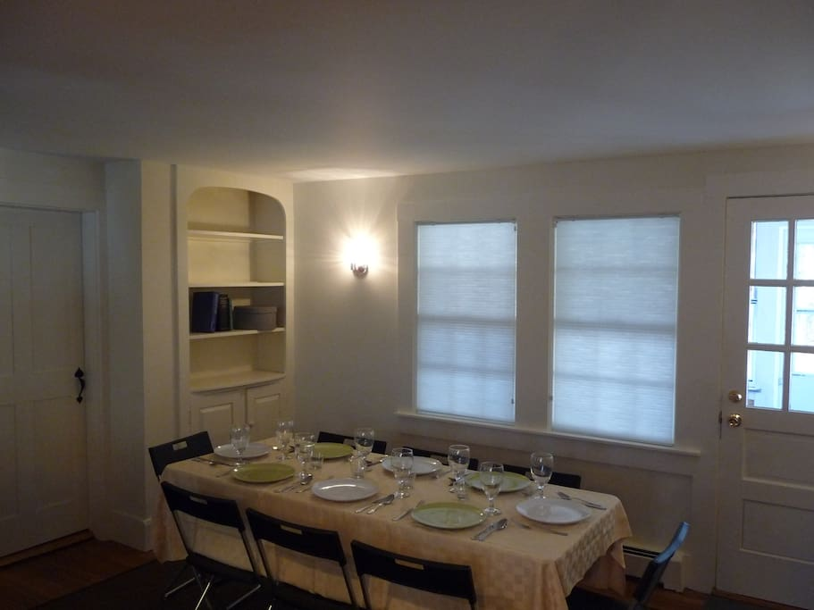 The dining area opens to the three season porch to right