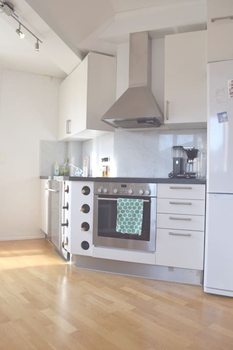 Fully equipped kitchen, including coffee maker and dishwasher.