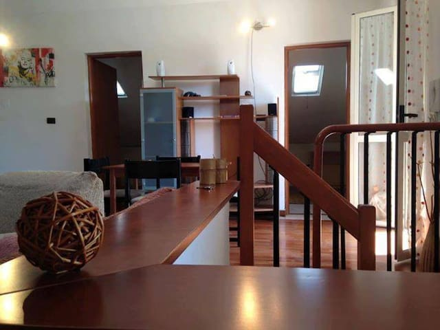 Casa mansardata con 2 camere singole