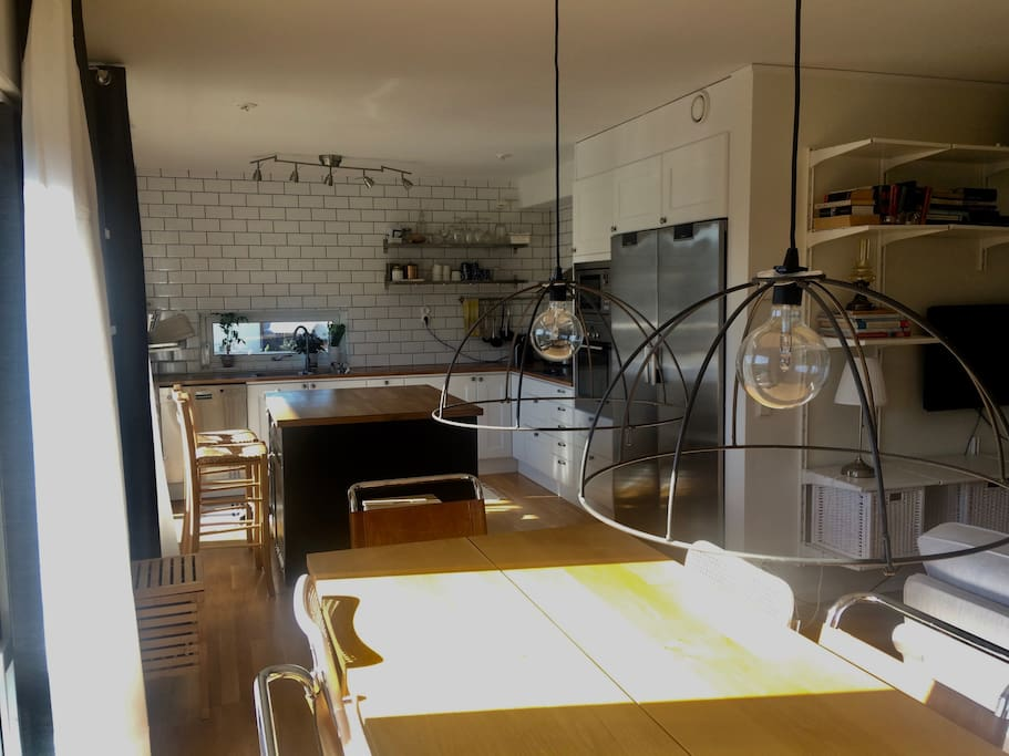 Kitchen diner which comfortably seats 8 people and seats for another 4 around kitchen island.