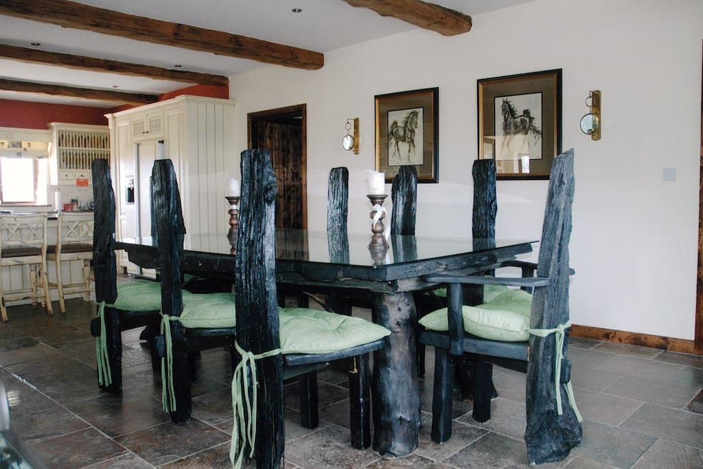 Fado's dining room is openly connected to the kitchen for easy meal preparation and transportation to the table during group meals.