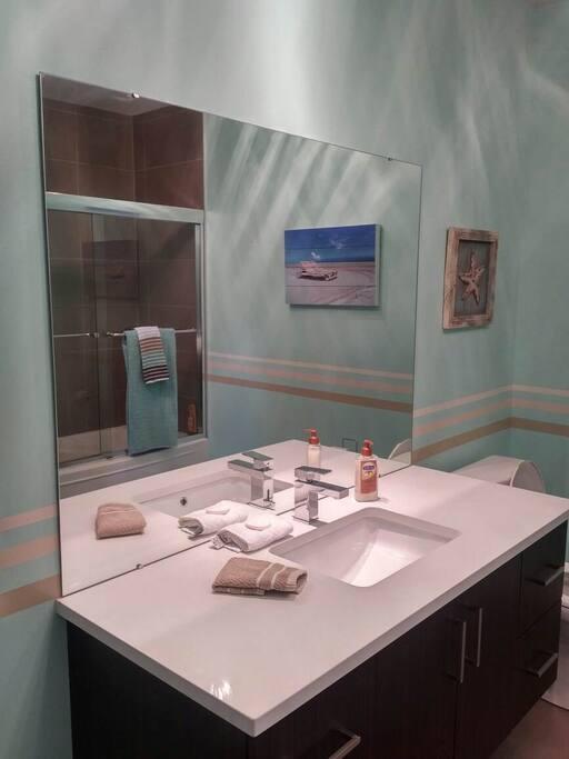 Spacious modern bathroom.  Laundry facilities. Iron & ironing board.