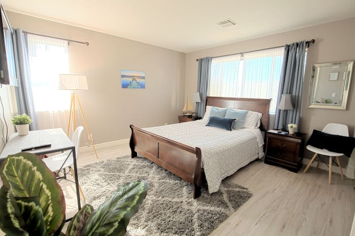 Spacious Master bedroom is on the main level with the adjoining bathroom.