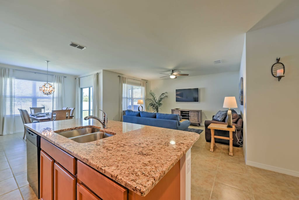 The home boasts pristine tile floors and an open-concept design with comfortable furnishings.