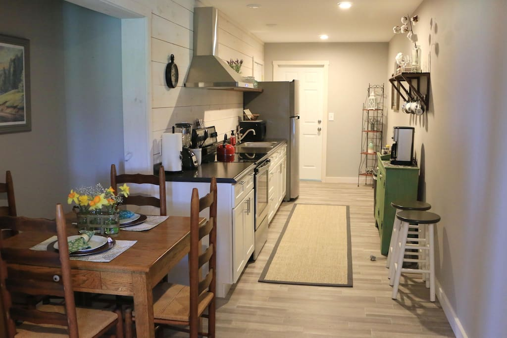 Fully furnished kitchen with brand new appliances and dining nook