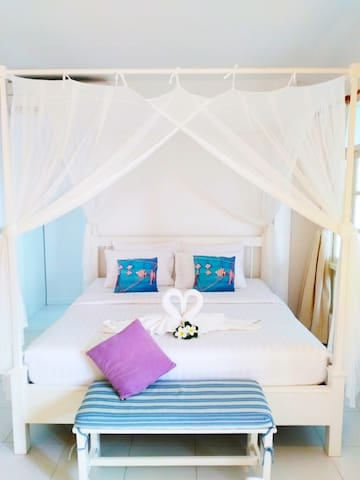 One Lovely Beachfront Bedroom