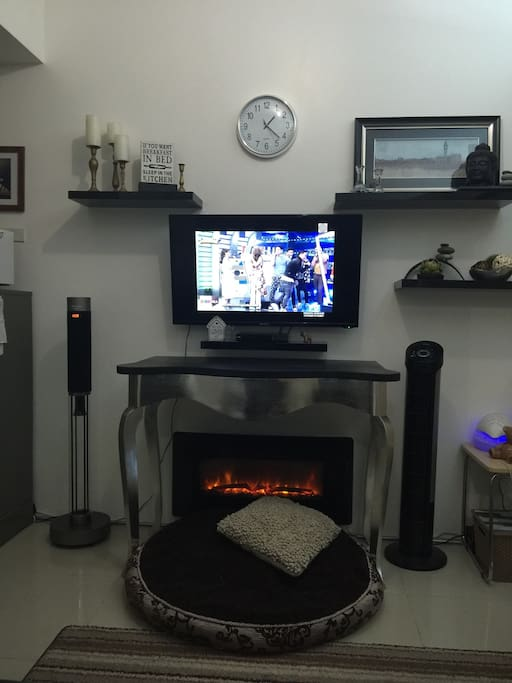 42 inches tv, audio tower, ambient fireplace