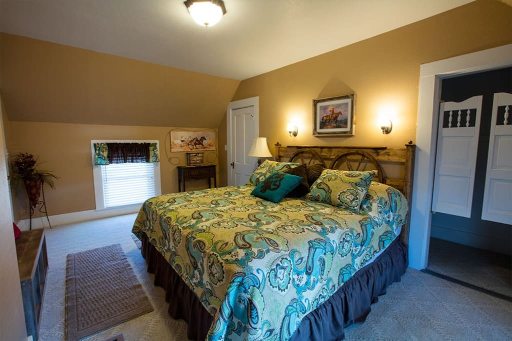 The Cowpoke's Retreat features a large space with a king bed and walk-in closet.