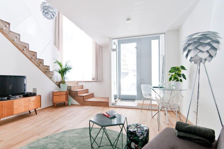 Modern in Mint - Galerie-Wohnung in zentraler Lage