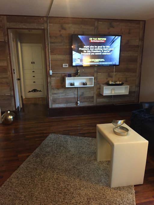 Large living room with 65 in TV hooked to roku view from main couch/sofa