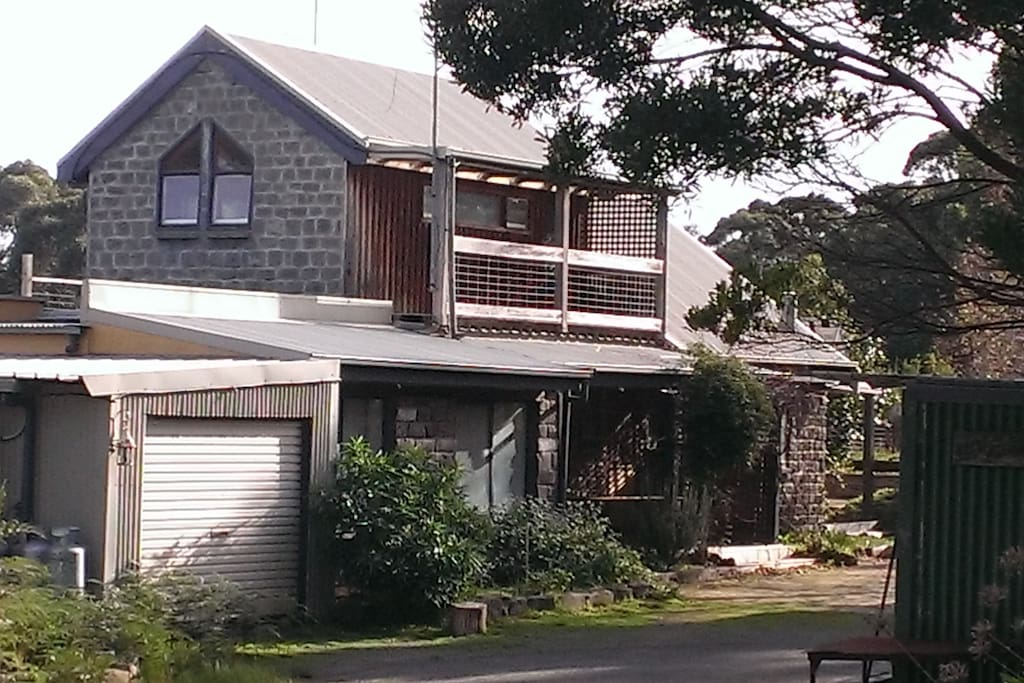 The apartment is downstairs and fully self-contained. The bedrooms catch the morning sun, and the living room has stunning views across Johanna Beach to Moonlight Head.