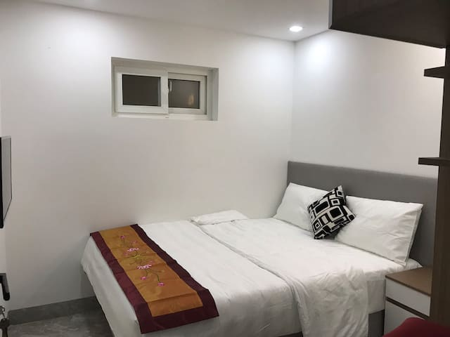 2sd bedroom with a comfy bed, closet, aircon, side table, smart TV, makeup table, hair dryer