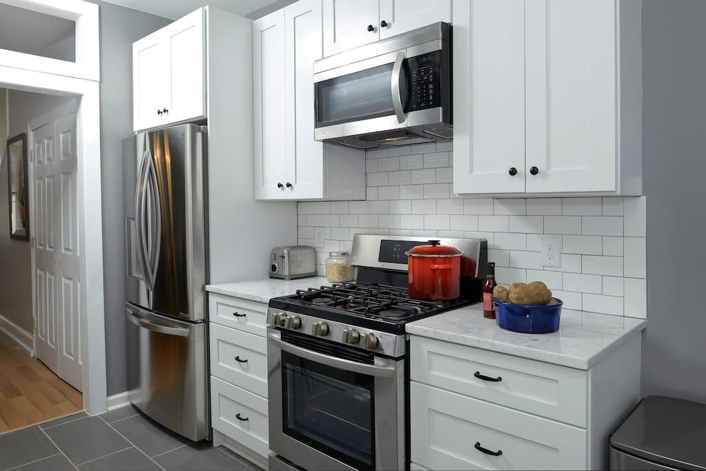 full sized refrigerator and gas stove