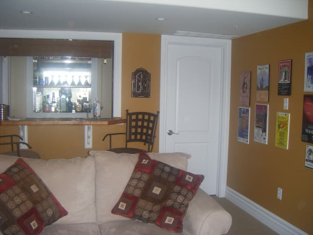 Living room with a bar.