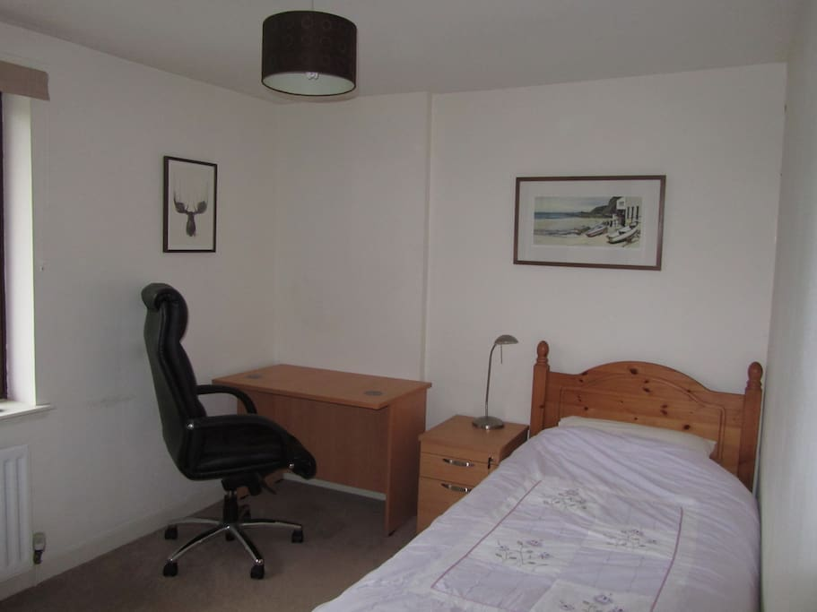 Good size single bedroom with workspace and fitted wardrobe.