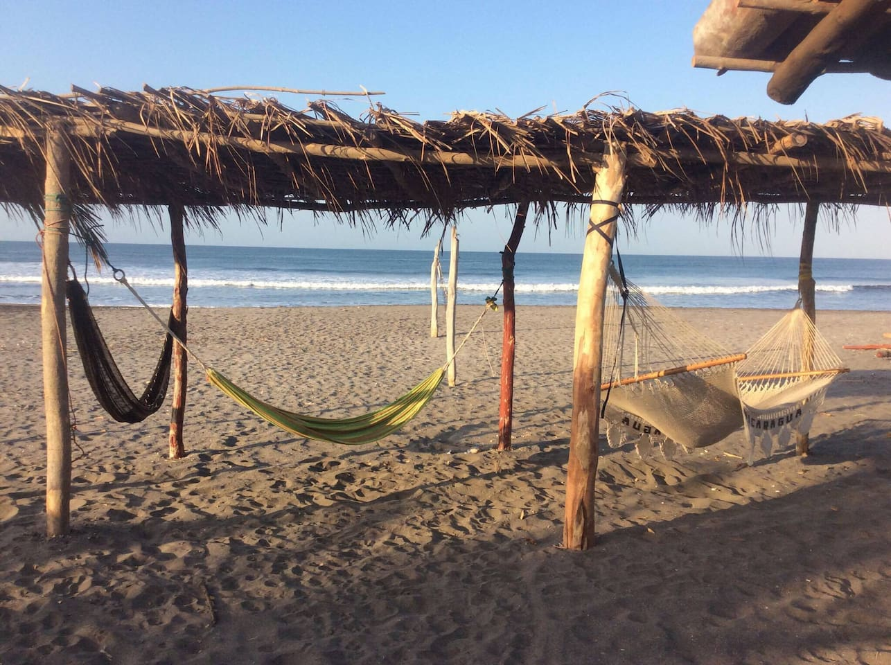 Relaxing hammocks in the sand