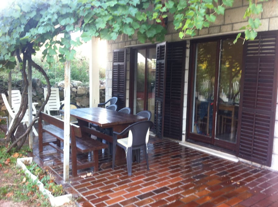Shaded terrace with loads of space for relaxing and dinning.