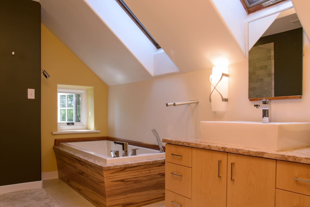 Luxurious soaking tub and a heated floor in your private bathroom