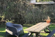 Large tree lined yard to relax in the sunshine.