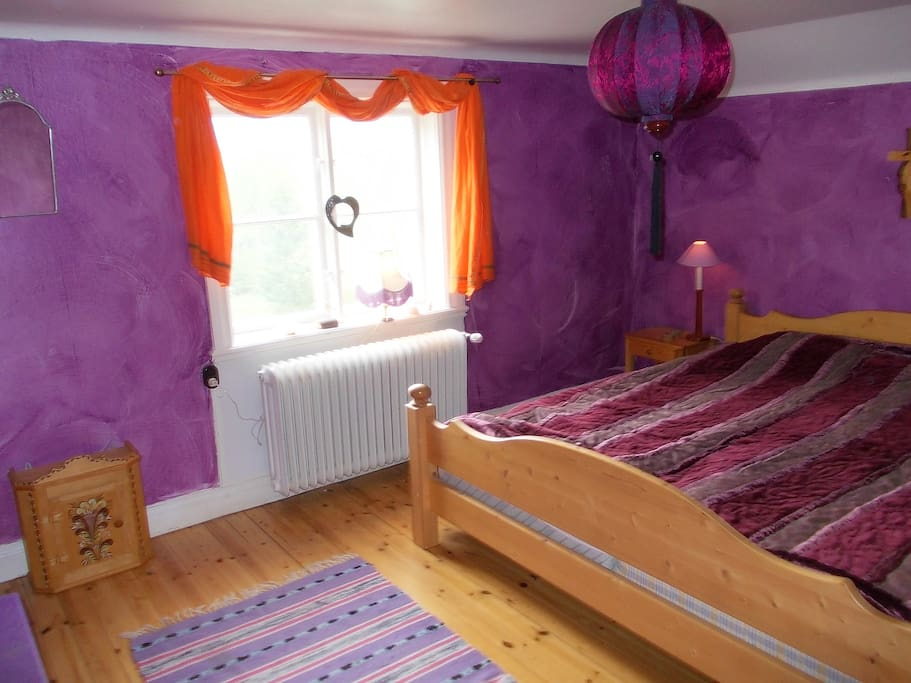 Double bed (queen size).  Overlooking garde and lake.