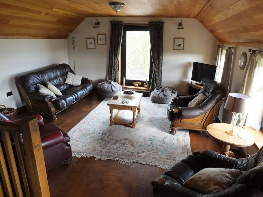 upstairs living room with log burner (logs supplied) stunning views from the windows.  Fantastic room cosy and with character