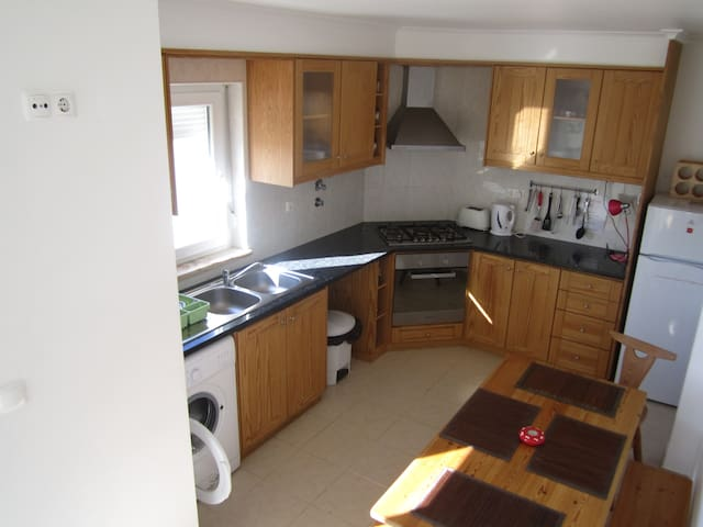 Large sunny upstairs kitchen with balcony