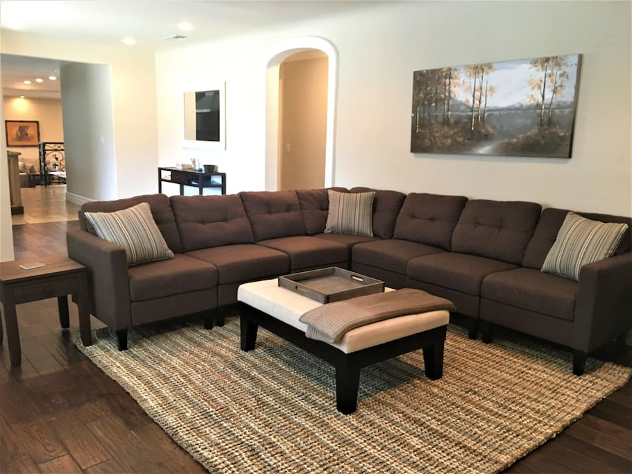 Enjoy the living room with a sofa that can fit in just about everyone in your group!