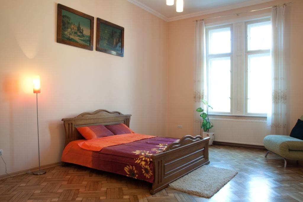 All three rooms are separate, very bright and airy. In the bedroom there are double bed with orthopedic mattress, old tiled stove.