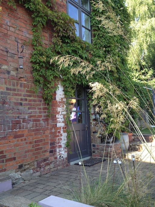 outside of studio with private access from public footpath and garden