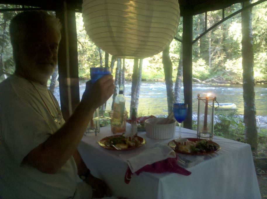 dinner in the gazebo on the beach and water of the McKenzie River