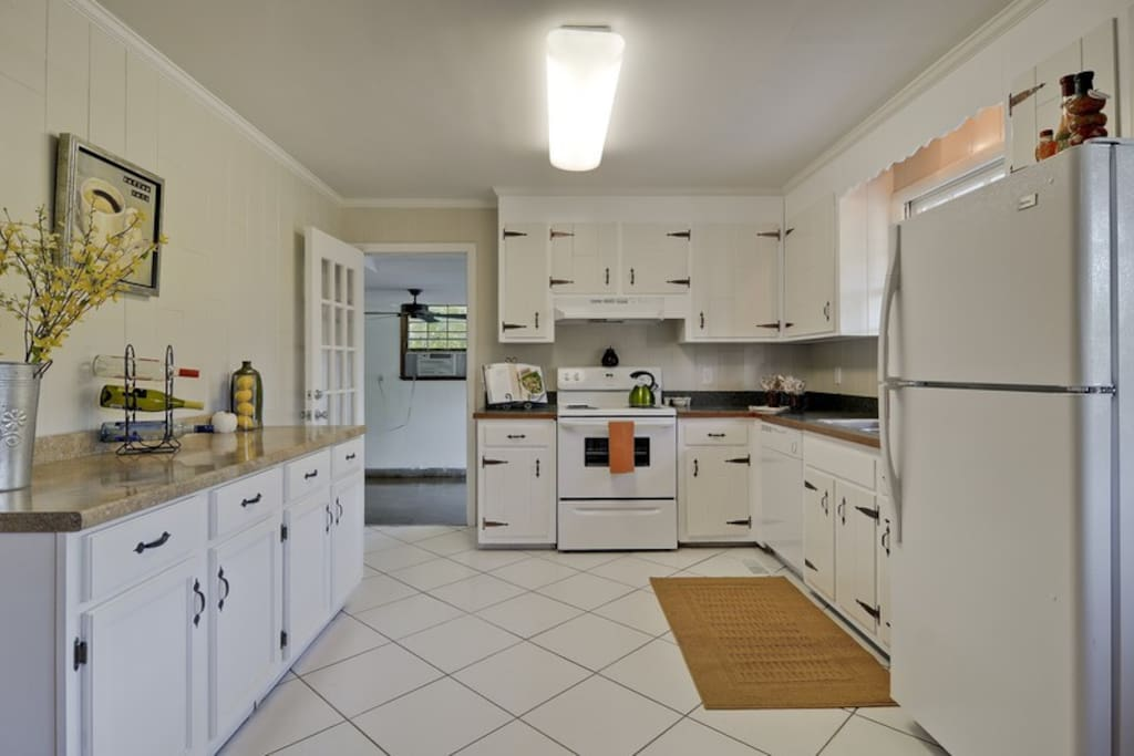 Bright open kitchen includes dishwasher  and microwave and everything you need to make and serve a delicious meal!